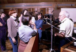 Music director John Lesko with members of the chorus